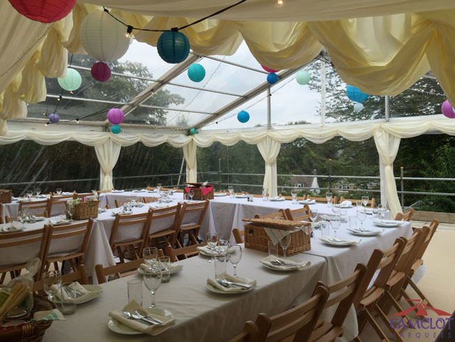 Trestle tables with linen joined together to make a sociable wedding breakfast