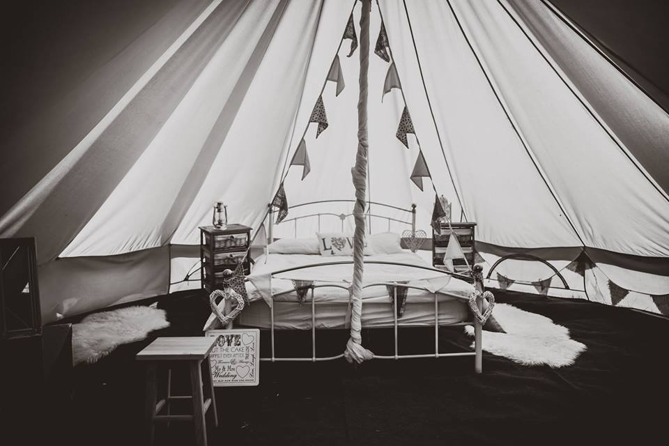 Bride and Groom interior of bell tent