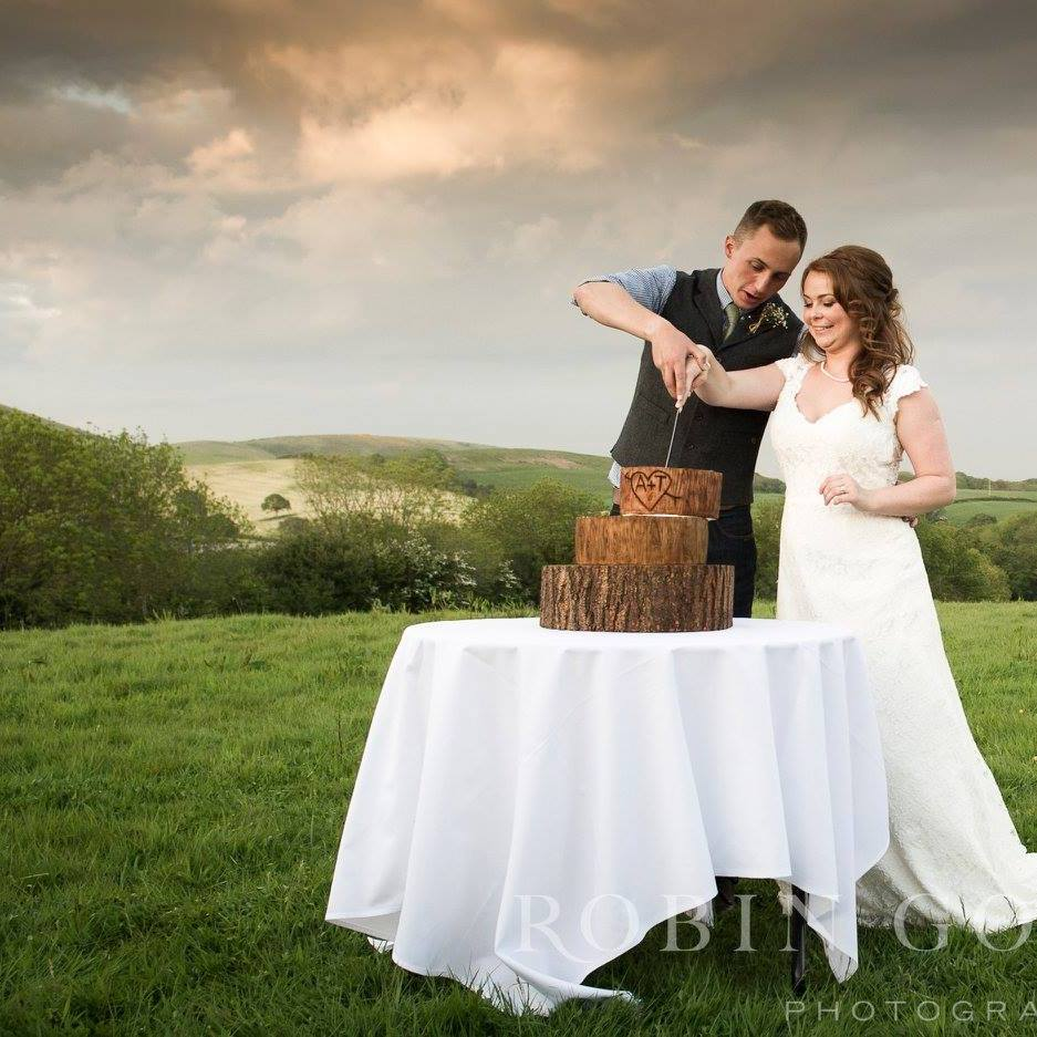 Cutting the cake with Purbeck hills behind